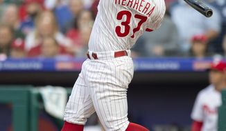 Philadelphia Phillies' Odubel Herrera (37) follows through on a three run home run in the first inning of a baseball game against the San Francisco Giants, Monday, May 7, 2018, in Philadelphia. (AP Photo/Laurence Kesterson)