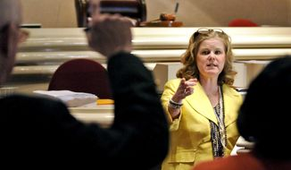 FILE - In this April 12, 2011 file photo, Sue Bell Cobb, then Alabama Supreme Court Chief Justice, points to a reporter with a question after she spoke about cuts having to be made within the judicial system in Alabama during a press conference in the House Chamber of the Alabama State House in Montgomery, Ala. Cobb was just 25 when she put on a judge's robe for the first time, beginning a 30-year judicial career that culminated with being elected chief justice of the Alabama Supreme Court in 2006. After decades on the bench - and seven years out of public office - Cobb, who was one of the last Democrats elected to statewide office in Alabama, is stepping back into the political arena, this time running for governor.  (Lloyd Gallman /The Montgomery Advertiser via AP, File)