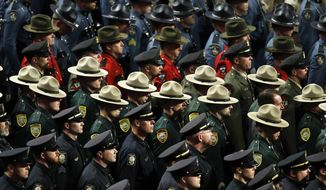Hundreds of law enforcement officers attend the funeral Cpl. Eugene Cole at the Cross Insurance Center Monday, May 7, 2018, in Bangor, Maine. Cole, a sheriff's deputy, was the first officer to be killed in the line of duty in Maine in early 30 years when he was killed early on April 25 in Norridgewock. (AP Photo/Robert F. Bukaty)