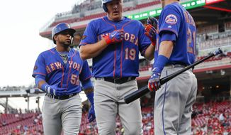 New York Mets' Jay Bruce (19) celebrates with Todd Frazier (21) after hitting a two-run home run off Cincinnati Reds starting pitcher Homer Bailey in the third inning of a baseball game, Monday, May 7, 2018, in Cincinnati. (AP Photo/John Minchillo)