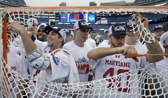 FILE - In this May 29, 2017, file photo, Maryland players cut the net to celebrate after their victory over Ohio State in the NCAA college Division 1 lacrosse championship final in Foxborough, Mass. Defending champion Maryland is the top seed for the men's NCAA lacrosse tournament. The first round starts Saturday, May 12, 2018. (AP Photo/Elise Amendola) ** FILE **