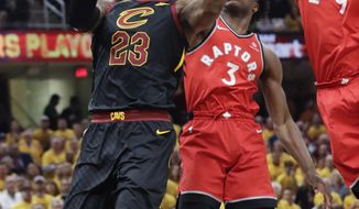 Cleveland Cavaliers' LeBron James (23) goes up to shoot against Toronto Raptors' Serge Ibaka (9), from Republic of Congo, and OG Anunoby (3) in the first half of Game 4 of an NBA basketball second-round playoff series, Monday, May 7, 2018, in Cleveland. (AP Photo/Tony Dejak)