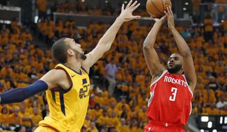 Utah Jazz center Rudy Gobert (27) defends against Houston Rockets guard Chris Paul (3) during the first half in Game 4 of an NBA basketball second-round playoff series Sunday, May 6, 2018, in Salt Lake City. (AP Photo/Rick Bowmer)