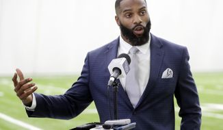 Former Tennessee Titans safety Michael Griffin speaks at a news conference after signing a one-day contract with the team and then retiring as a Titan Monday, May 7, 2018, in Nashville, Tenn. Griffin, a first-round pick by the Titans in 2007, played nine seasons for Tennessee. (AP Photo/Mark Humphrey)