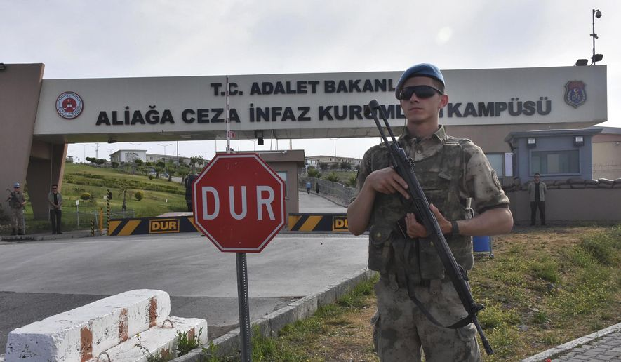 A Turkish soldier guards the entrance to the prison complex in Aliaga, Izmir province, western Turkey, where jailed U.S. pastor Andrew Craig Brunson is appearing on his trial at a court inside the complex, Monday, May 7, 2018. The 50-year-old evangelical pastor from Black Mountain, North Carolina, faces up 35-years in prison in Turkey, on charges that he aided terror groups and engaged in espionage. The pastor of the Izmir Resurrection Church denies any wrongdoing. (DHA-Depo Photos via AP)