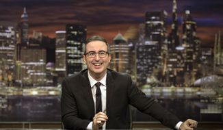 "This image released by HBO shows John Oliver, host of ""Last Week Tonight with John Oliver."" Oliver said Sunday that he'd achieved all he'd wanted for the show by having an Australian animal hospital's special ward to treat a chlamydia outbreak among koalas named for him. He said, ""goodbye, forever, everyone,"" as stagehands broke up his set around him. That inspired a wave of social media posts among fans wondering if he was serious. (Eric Liebowitz/HBO via AP)"