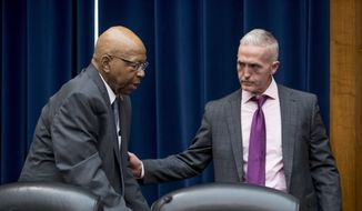 Chairman Trey Gowdy, R-S.C., right, helps Ranking Member Elijah Cummings, D-Md., left, to his seat before a House Oversight and Government Reform Committee hearing on the 2020 Census, on Capitol Hill, Tuesday, May 8, 2018, in Washington. Cummings has been recovering from two surgeries after developing a knee infection late last year. (AP Photo/Andrew Harnik) ** FILE **