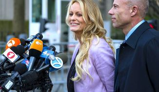 Adult film actress Stormy Daniels faces the news media in New York City following a court appearance, accompanied by her attorney. (Associated Press)