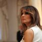 First lady Melania Trump listens during a news conference with President Donald Trump and Japanese Prime Minister Shinzo Abe at Trump's private Mar-a-Lago club, Wednesday, April 18, 2018 in Palm Beach, Fla.     Associated Press photo