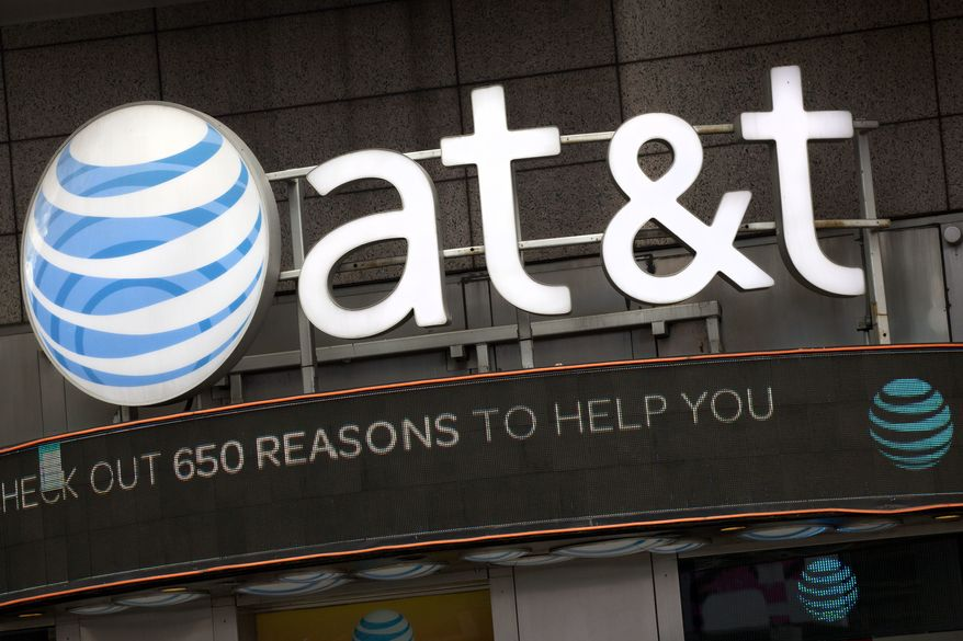 FILE - In this Monday, Oct. 24, 2016, file photo, the AT&T logo is positioned above one of its retail stores, in New York. AT&T Inc. reports earnings Tuesday, April 25, 2017. (AP Photo/Mark Lennihan, File)