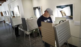 """""""During the 2016 election, Russian entities targeted presidential campaign accounts, launched cyber-attacks against at least 21 state election systems, and hacked a US voting systems software company,"""" committee member Sen. James Lankford, Republican Oklahoma in a press release accompanying the report. (AP Photo/John Minchillo)"""