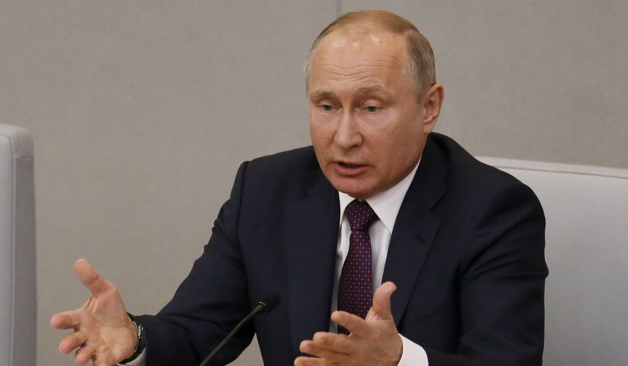 Russian President Vladimir Putin gestures while speaking during a meeting of the State Duma, Russian parliament's lower house, in Moscow, Russia, Tuesday, May 8, 2018. (AP Photo/Alexander Zemlianichenko) ** FILE **