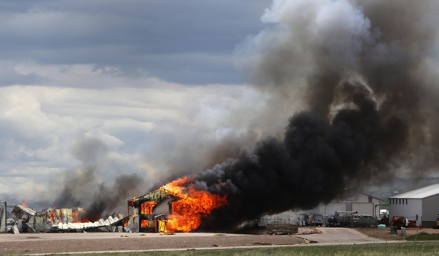The Ultramax Ammunition company is engulfed in flames Tuesday, May 8, 2018, north of Interstate 90 and just east of Rapid City, S.D. Fire crews were worried about exploding ammunition and evacuated the area around the blaze. (Chris Huber /Rapid City Journal via AP)