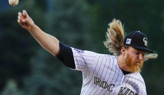 Colorado Rockies starting pitcher Jon Gray throws to a Los Angeles Angels batter during the first inning of a baseball game Tuesday, May 8, 2018, in Denver. (AP Photo/Jack Dempsey)