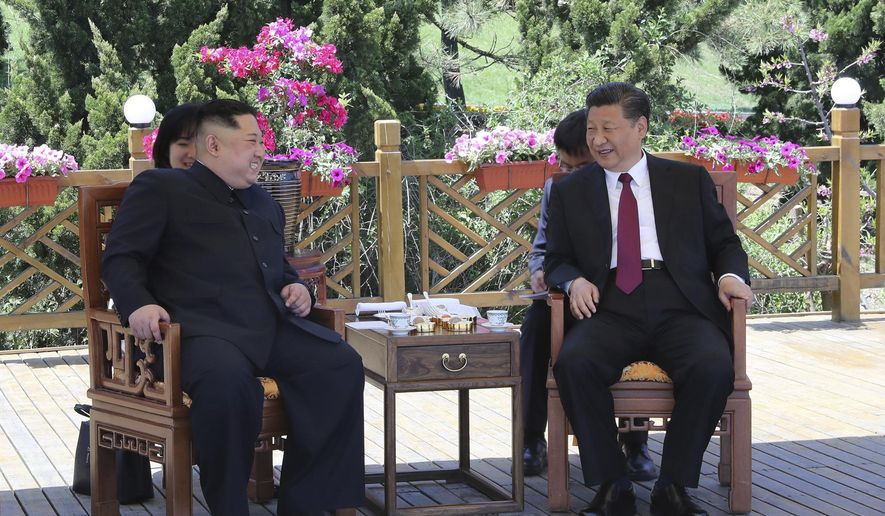 In this photo taken between May 7 and 8, 2018 released by Xinhua News Agency, Chinese President Xi Jinping, right speaks to North Korean leader Kim Jong Un in Dalian in northeastern China's Liaoning Province. (Ju Peng/Xinhua via AP)