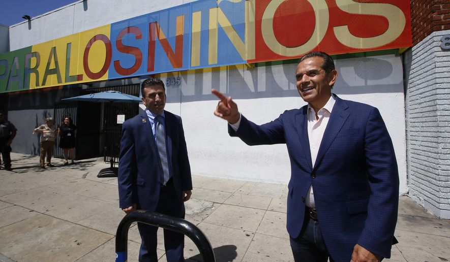 Gubernatorial candidate Antonio Villaraigosa, the former mayor of Los Angeles and state Assembly speaker, right, visits Para Los Ninos Education Center, a social service and education organization dedicated to serve needy children and families in Los Angeles Monday, May 7, 2018. Drew Furedi, left, the center's President and CEO, stands beside Villaraigosa. The Democratic front-runner, Gavin Newsom, wants to face a Republican, but rival John Cox is locked in a struggle for second place with Villaraigosa, a Democrat. (AP Photo/Damian Dovarganes)