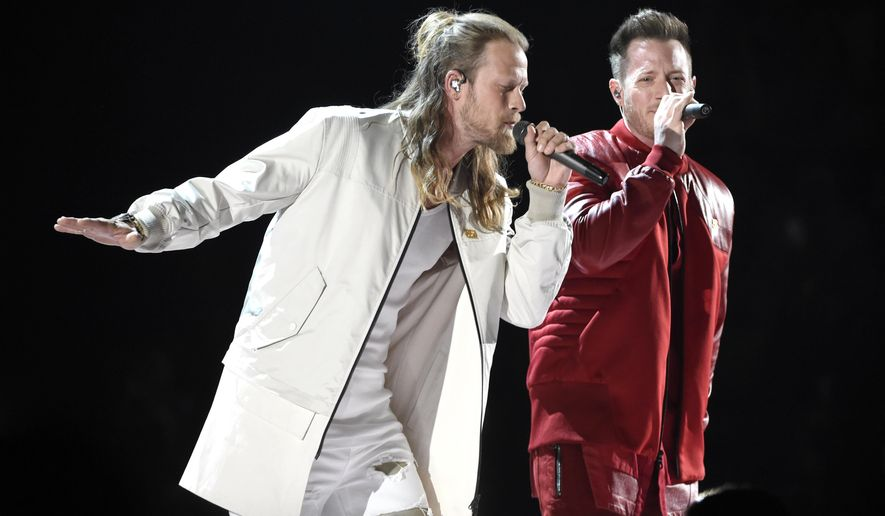 "FILE - In this April 15, 2018 file photo, Tyler Hubbard, right, and Brian Kelley, of Florida Georgia Line, perform ""Meant to Be"" at the 53rd annual Academy of Country Music Awards in Las Vegas. The duo, along with Carrie Underwood and Jason Aldean are the leading nominees for the CMT Music Awards with four each. Little Big Town, who are nominated for three awards, will host the show, which airs on June 6 at 8 p.m. Eastern on CMT. (Photo by Chris Pizzello/Invision/AP)"