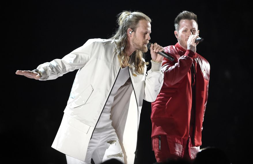 """FILE - In this April 15, 2018 file photo, Tyler Hubbard, right, and Brian Kelley, of Florida Georgia Line, perform """"Meant to Be"""" at the 53rd annual Academy of Country Music Awards in Las Vegas. The duo, along with Carrie Underwood and Jason Aldean are the leading nominees for the CMT Music Awards with four each. Little Big Town, who are nominated for three awards, will host the show, which airs on June 6 at 8 p.m. Eastern on CMT. (Photo by Chris Pizzello/Invision/AP)"""