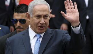 Israeli Prime Minister Benjamin Netanyahu waves to the media as leaves the presidential palace after a meeting with Greek Prime Minister Alexis Tsipras and Cyprus' president Nikos Anastasiades in capital Nicosia, Cyprus, on Tuesday, May 8, 2018. Cyprus hosted the Israeli Prime Minister and Greek Prime Minister in another trilateral meeting between the three leaders aimed at forging closer relations and cooperation on fields including energy, security, the environment, business and tourism. (AP Photo/Petros Karadjias)