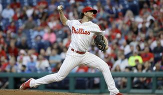 Philadelphia Phillies' Aaron Nola pitches during the third inning of a baseball game against the San Francisco Giants, Tuesday, May 8, 2018, in Philadelphia. (AP Photo/Matt Slocum)