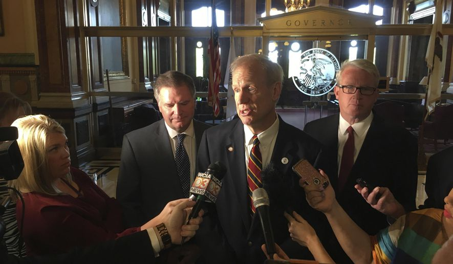 Gov. Bruce Rauner, center, addresses reporters outside his state Capitol office Tuesday, May 8, 2018, with Senate Minority Leader Bill Brady, R-Bloomington, left, and House Minority Leader Jim Durkin, R-Westchester in Springfield, Ill. Rauner, a Republican, and the GOP legislative leaders want Democrats to reach agreement with them on a state budget plan before the May 31 scheduled adjournment of the Legislature. (AP Photo by John O'Connor)