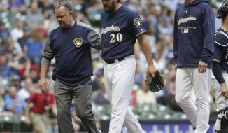 Milwaukee Brewers starting pitcher Wade Miley leaves the game after an injury during the first inning of a baseball game against the Cleveland Indians Tuesday, May 8, 2018, in Milwaukee. (AP Photo/Morry Gash)