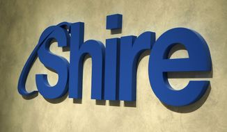 This April, 2018 photo, shows a logo of Shire in Tokyo. Japanese drugmaker Takeda has agreed to buy Shire Plc for 46 billion pounds ($62.4 billion) in cash and stock, one of the biggest deals ever in the pharmaceuticals industry, the companies said in statements Tuesday, May 8, 2018. (Kyodo News via AP)