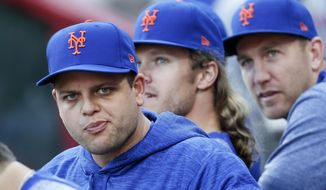 New York Mets' Devin Mesoraco waits for the team's baseball game against the Cincinnati Reds, Tuesday, May 8, 2018, in Cincinnati. Mosoraco was traded by the Reds to the Mets earlier Tuesday. (AP Photo/John Minchillo)
