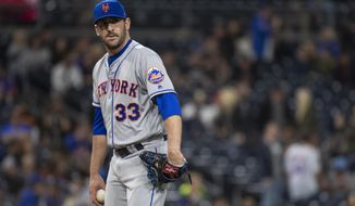 FILE - In this April 27, 2018, file New York Mets relief pitcher Matt Harvey pauses during the ninth inning of the team's baseball game against the San Diego Padres in San Diego. The Mets have traded former ace Harvey to the Cincinnati Reds for catcher Devin Mesoraco in a swap of former All-Stars with careers sidetracked by injuries. The deal was announced less than an hour before the first pitch of Tuesday night's game between the Mets and Reds in Cincinnati. (AP Photo/Kyusung Gong, File)