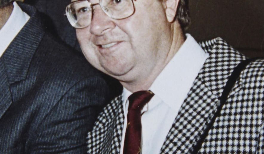 In this undated photo, former Associated Press photographer Russell McPhedran smiles while on assignment in Australia. McPhedran, who was inducted into the Australian Media Hall of Fame in November, 2017, worked at the Sydney bureau of the Associated Press from 1985 until his retirement nearly 20 years later. McPhedran died Monday, May 7, 2018, after a heart-related illness. He was 82. (AP Photo)