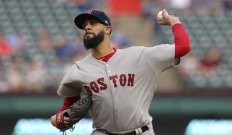 FILE - In this May 3, 2018 file photo Boston Red Sox starting pitcher David Price throws to a Texas Rangers batter during the first inning of a baseball game in Arlington, Texas. Price has been sent back to Boston for medical tests after experiencing a tingling sensation in his pitching hand again.Price was scratched from his scheduled start Wednesday, May 9, 2018 against the rival New York Yankees. Red Sox manager Alex Cora says Price felt tingling in his hand Sunday while throwing a bullpen that was cut short, the same symptoms that forced him out of an early-season game against the Yankees in Boston. (AP Photo/Richard Rodriguez)