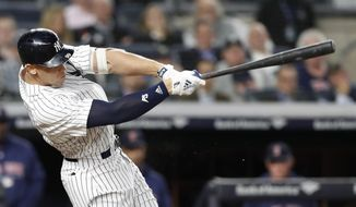 New York Yankees' Aaron Judge hits an RBI single in the seventh inning of a baseball game against the Boston Red Sox in New York, Tuesday, May 8, 2018. (AP Photo/Kathy Willens)