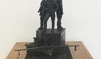 """FILE - This March 12, 2018 file photo shows a model of the """"Project Zebra"""" memorial in the Arts of the Albemarle building in Elizabeth City, N.C. The monument to Russian soldiers killed while training in the United States during World War II may still find a home in America even after Elizabeth City rejected it because of tensions between the two countries. (AP Photo/Martha Waggoner, File)"""