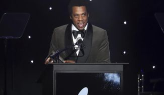 FILE - In this Jan. 27, 2018, file photo, honoree Jay-Z speaks onstage at the 2018 Pre-Grammy Gala And Salute To Industry Icons at the Sheraton New York Times Square Hotel in New York. Jay-Z must explain why he's dodging a subpoena rather than answering questions related to a financial investigation of a consumer brand company that bought his Rocawear clothing line, a judge says. In an order made public Thursday, May 3, U.S. District Judge Paul G. Gardephe instructed the performer and entrepreneur, whose birth name is Shawn Carter, to appear in a New York courtroom next Tuesday to explain himself. (Photo by Michael Zorn/Invision/AP, File)