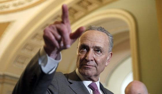 Senate Minority Leader Chuck Schumer of N.Y., points to a question during a media availability after a policy luncheon on Capitol Hill, Tuesday, May 8, 2018 in Washington. (AP Photo/Alex Brandon) ** FILE **