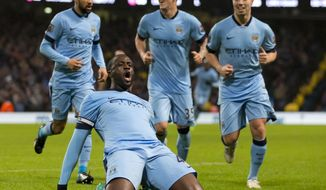 FILE - In this Thursday Jan. 1, 2015 file photo, Manchester City's Yaya Toure, bottom, celebrates after scoring against Sunderland during their English Premier League soccer match at the Etihad Stadium, Manchester, England. Yaya Toure is leaving Manchester City after eight years and plays his last home game for the club against Brighton on Wednesday, May 9, 2018. It is a chance for City fans to bid farewell to a midfielder who will go down as one of the club's greatest and most influential players ever, even if he played a peripheral role in this season's Premier League title triumph. (AP Photo/Jon Super, file)