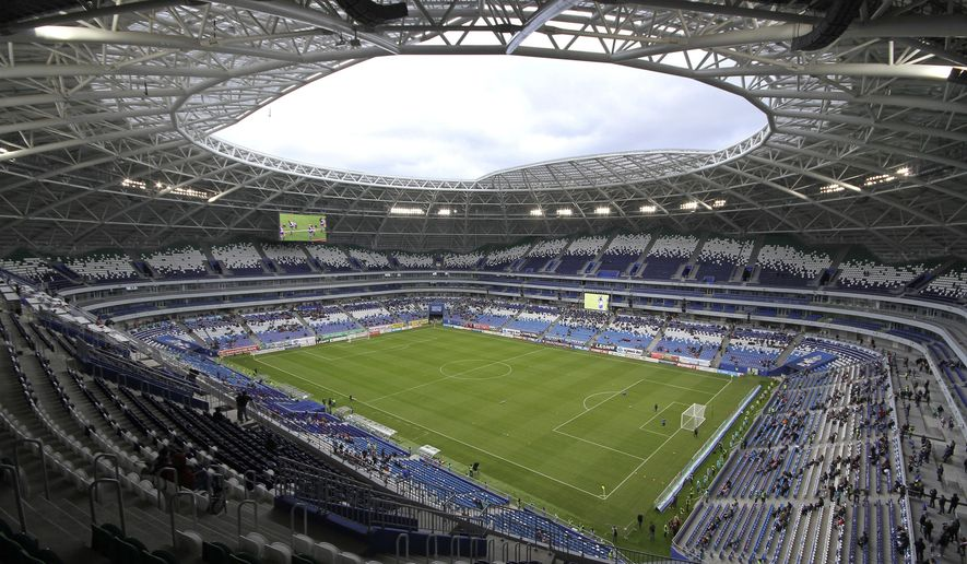 In this photo taken on Saturday, April 28, 2018, a view on the new the World Cup stadium in Samara prior to the Russian league soccer match between Krylia Sovetov (Wings of Soviets) and Fakel (Torch), Russia. (AP Photo/Yuri Strelets)