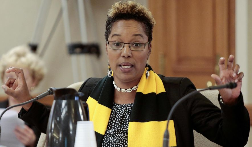 """FILE - In this May 29, 2015 file photo, Wisconsin state Sen. Lena Taylor, D-Milwaukee, gestures while speaking at the State Capitol in Madison. Taylor said Monday, May 7, 2018, that she used """"controversial"""" language during an argument with a Milwaukee bank teller April 6 but thought she could speak that way because both of them are black and conversations in black culture are different than in other settings. (Michael P. King/Wisconsin State Journal via AP, File)"""