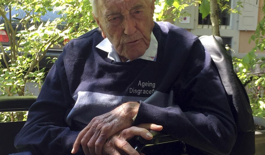 104-year-old Australian scientist David Goodall sits in a wheelchair in Basel, Switzerland, Tuesday, May 8, 2018. (AP Photo/Jamey Keaten)