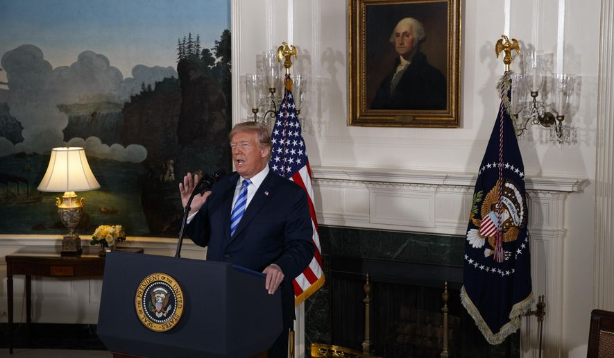 """President Donald Trump delivers a statement on the Iran nuclear deal from the Diplomatic Reception Room of the White House, Tuesday, May 8, 2018, in Washington. Trump says the United States is withdrawing from the Iran nuclear deal, which he called """"defective at its core.""""  (AP Photo/Evan Vucci)"""