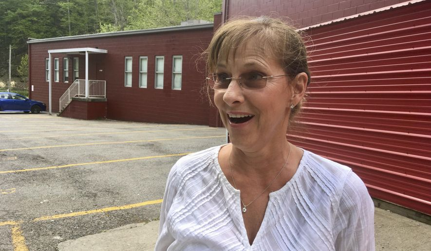 Cheryl Dolan of Alum Creek, W.Va, discusses her vote in the West Virginia Republican primary Tuesday, May 8, 2018, outside a polling place in Alum Creek. She said she appreciates the work that state Sen. Richard Ojeda of Logan County did to advance a bill through the West Virginia Legislature last year to make medical marijuana legal. Dolan has back problems and so do many members of her family and would like to see medical marijuana become available more quickly to help West Virginians with chronic health issues. (AP Photo/John Raby)