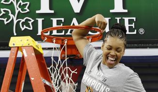 In this March 11, 2018 photo, Princeton's Leslie Robinson reacts as she cuts her piece of the net after an NCAA college basketball championship game in the Ivy League Tournament against Pennsylvania in Philadelphia. Robinson joined an exclusive club when she was drafted by the New York Liberty last month. The former Princeton star is just the third player with Ivy League experience to be taken in the WNBA draft, joining Allison Feaster and Temi Fagbenle. While Robinson's a longshot to make the Liberty, she's happy to have the opportunity. (AP Photo/Chris Szagola)