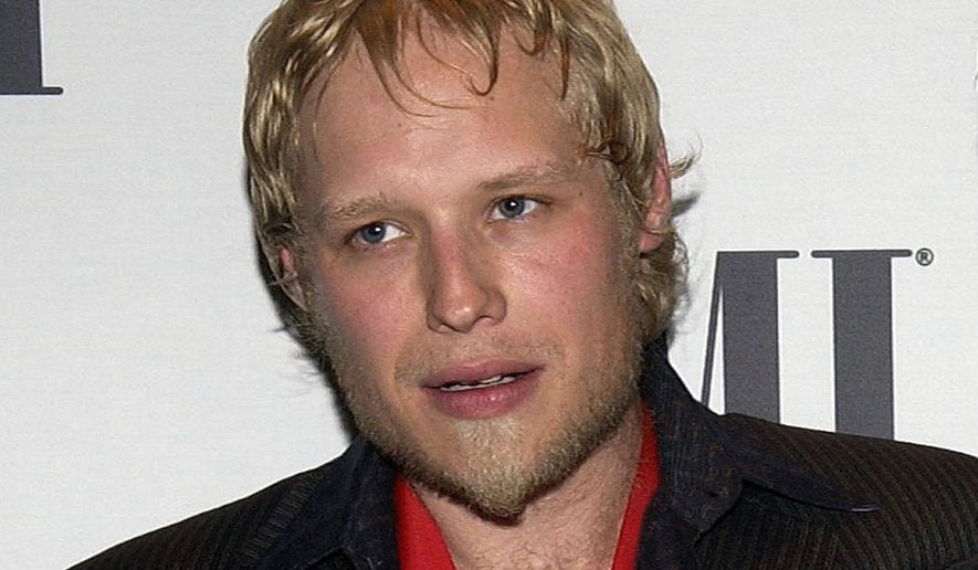 FILE - In this May 17, 2005, file photo, 3 Doors Down member Matt Roberts arrives at the BMI Pop Music Awards in Beverly Hills, Calif. Dr. Richard Snellgrove of Fairhope, Ala., an Alabama physician, is scheduled to go on trial Friday, May 11, 2018, on charges that he improperly prescribed fentanyl and other drugs to 3 Doors Down guitarist Matthew Roberts, who died of a drug overdose. (AP Photo/Matt Sayles, File)