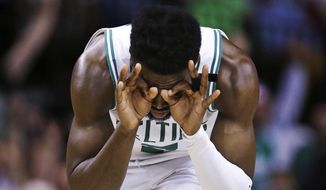 Boston Celtics guard Jaylen Brown reacts after hitting a 3-pointer against the Philadelphia 76ers during the third quarter of Game 5 of an NBA basketball playoff series in Boston, Wednesday, May 9, 2018. (AP Photo/Charles Krupa) **FILE**