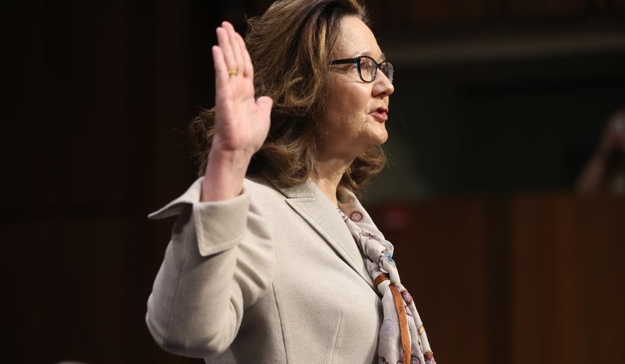 CIA nominee Gina Haspel is sworn in during a confirmation hearing of the Senate Intelligence Committee, on Capitol Hill, Wednesday, May 9, 2018 in Washington. (AP Photo/Pablo Martinez Monsivais)