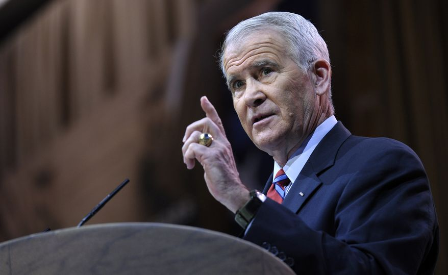 Retired Lt. Col. Oliver North, USMC, speaks at the Conservative Political Action Committee annual conference in National Harbor, Md., Friday, March 7, 2014. Friday marks the second day of the annual Conservative Political Action Conference, which brings together prospective presidential candidates, conservative opinion leaders and tea party activists from coast to coast. (AP Photo/Susan Walsh)