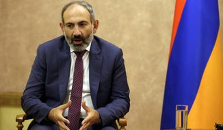Armenia's Prime Minister Nikol Pashinian speaks with the President Bako Sahakyan of the separatist Nagorno-Karabakh region speaks during their meeting in the capital Stepanakert, Wednesday, May 9, 2018. Nagorno-Karabakh, part of Azerbaijan has been under the control of local ethnic Armenian forces and the Armenian military since a war ended in 1994 with no resolution of the region's status. (AP Photo/Thanassis Stavrakis)