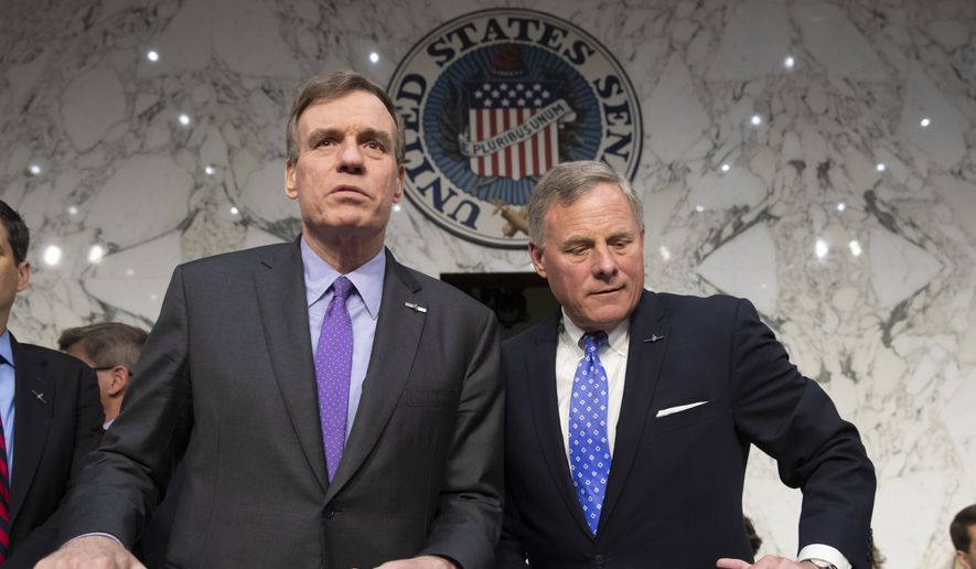 Senate Intelligence Committee Vice Chairman Mark Warner, D-Va., left, and Sen. Richard Burr, R-N.C., the panel chairman, arrive to hear from Gina Haspel, President Donald Trump's pick to lead the Central Intelligence Agency, during her confirmation hearing on Capitol Hill in Washington, Wednesday, May 9, 2018. (AP Photo/J. Scott Applewhite)