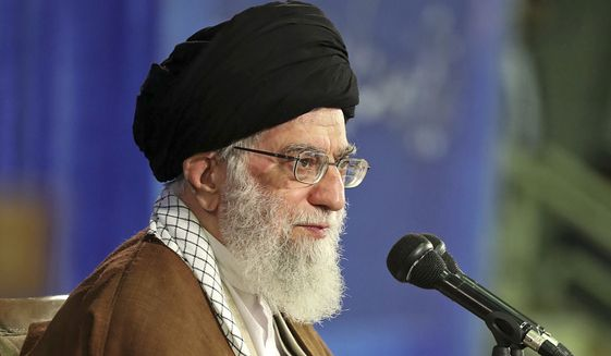 """In this photo released by an official website of the office of the Iranian supreme leader, Supreme Leader Ayatollah Ali Khamenei attends a meeting with a group of school teachers in Tehran, Iran, Wednesday, May 9, 2018. Khamenei has challenged President Donald Trump over America pulling out of the nuclear deal, saying, """"You can not do a damn thing!"""" a day after Trump announced he was renewing sanctions on Iran. (Office of the Iranian Supreme Leader via AP)"""