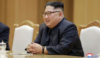 In this Wednesday, May 9, 2018, photo provided on Thursday, May 10, 2018, by the North Korean government, North Korean leader Kim Jong-un attends a meeting with U.S. Secretary of State Mike Pompeo at the Workers' Party of Korea headquarters in Pyongyang, North Korea. (Korean Central News Agency/Korea News Service via AP)